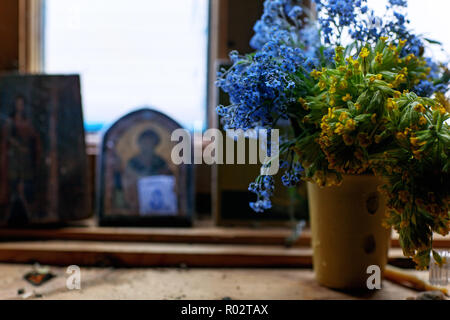 Still life with wild flowers and Russian icon - Stock Image