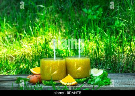 Fruit smoothie. On the summer background - Stock Image