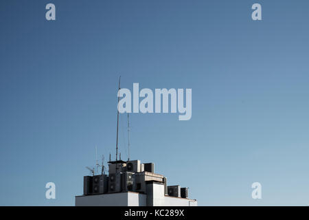 Air conditioning units and aerials above a residential property in Lloret de Mar - Stock Image
