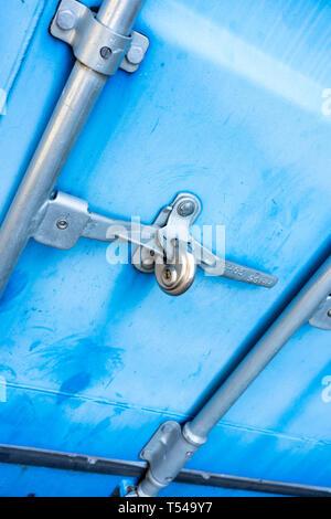 Steel door secured with padlock - Stock Image