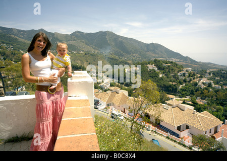 Mother and toddler sightseeing in Mijas Pueblo, Costa del Sol, Andalucia, Spain - Stock Image