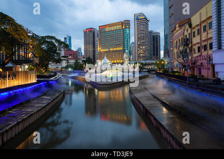 Kuala Lumpur, Malaysia - January 30, 2019: The view of the renovated area around Masjid Mosque with water and light show on the foreground on January  - Stock Image