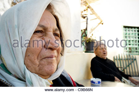 Old senior Turkish woman and man husband in Greece - Stock Image