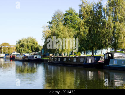 The Great Ouse river flowing through the pretty cathedral town of Ely, Cambridgeshire is popular with boating enthusiasts and barge dwellers. - Stock Image