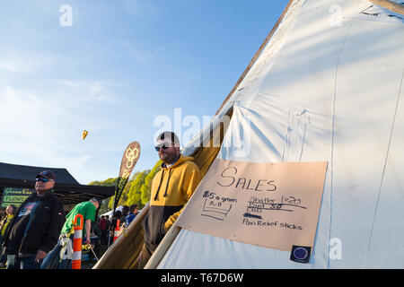 VANCOUVER, BC, CANADA - APR 20, 2019: A man leaving a tent that is selling cannabis and related products at the 420 festival in Vancouver, Canada. - Stock Image