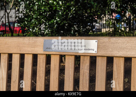Wooden bench commemorating Adrian Steel, lawyer, Lincoln's Inn Fields, Holborn, London, England - Stock Image