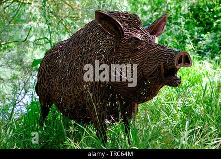 life size metal boar. pensthorpe nature reserve, norfolk, england - Stock Image