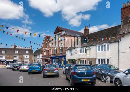 Parked cars and flag bunting, Oakham Market Place, Rutland, England, UK - Stock Image