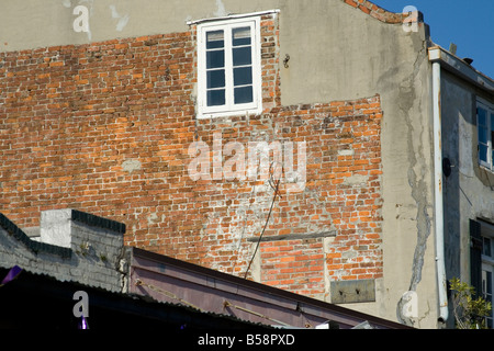 Window in a brick wall of a residential structure - Stock Image
