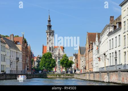 Belgium, Western Flanders, Bruges, historical centre listed as World Heritage by UNESCO, Canal leading to Jan Van Eyck square and the former Hansa quarter - Stock Image
