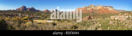 Wide Panoramic Scenic View of Sedona City and Arizona Desert Red Rock Landscape from Schnebly Loop Hiking Trail on Sunny Late Autumn Day - Stock Image