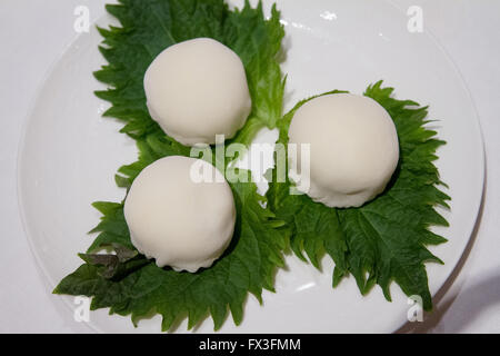Soft glutinous mixed chilled fruits filled rice balls dessert 'Xue mei Niang' served at the Shang Palace - Stock Image