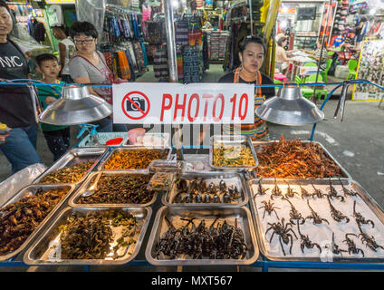 Street Vendor selling fried insects on Khao San Road, Bangkok, Thailand, - Stock Image