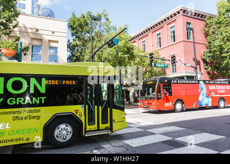 Orlando Florida Downtown Historic District Magnolia Avenue corner intersection building Lynx bus public transportation biodiesel - Stock Image