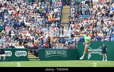 Eastbourne, UK. 24th June, 2019. John Millman of Australia in action serving as the crowd take their seats during his defeat to Fernando Verdasco of Spain in their match at the Nature Valley International tennis tournament held at Devonshire Park in Eastbourne . Credit: Simon Dack/Alamy Live News - Stock Image