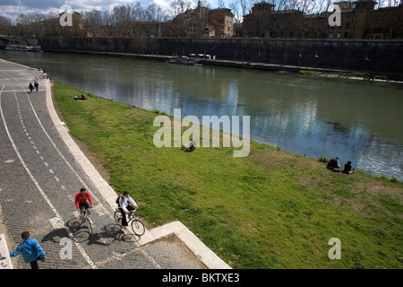 People exercise along the Tiber River in Rome, March 9, 2008. Photo/Chico Sanchez - Stock Image
