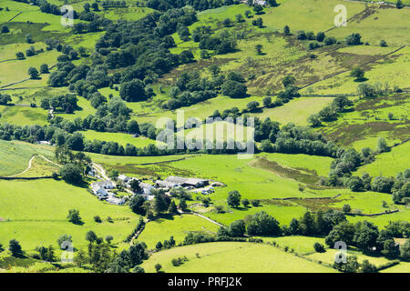 From the summit of Cat Bells,  looking down on the hamlet of Littletown and fields of green in Newlands valley Cumbria. - Stock Image