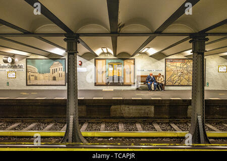 Sophie-Charlotte-Platz U-Bahn Underground railway station on the U2 rail line in Berlin-Charlottenburg.Grey tiled walls & Historic Pictures Of station - Stock Image