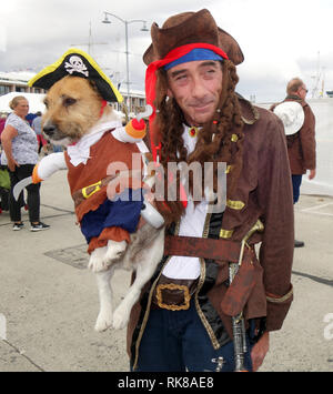Pirate with his dog who is also in pirate costume, Australian Wooden Boat Festival 2019, Hobart, Tasmania, Australia. No MR - Stock Image