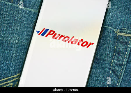 MONTREAL, CANADA - December 23, 2018: Purolator mobile android app on Samsung s8 screen. Purolator Inc. is a Canadian courier that is 91 percent owned - Stock Image