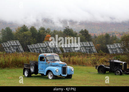 Vintage pick-up truck and solar panels, Waterbury, VT, USA - Stock Image
