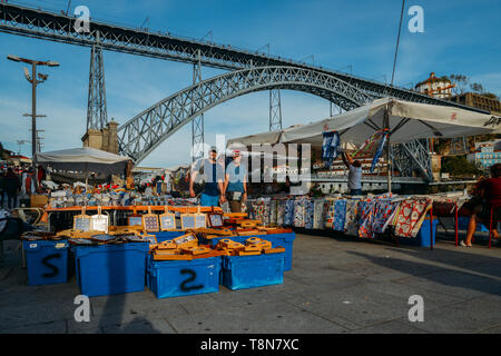 Porto, Portugal - April 29, 2019: Souvenirs for sale next to Dom Luis I bridge in the historic centre of Porto - UNESCO World Heritage - Stock Image