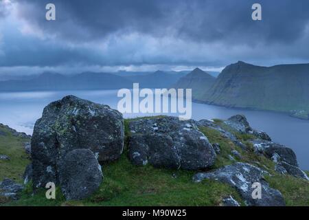 Stormy skies over Funningsfjørdur at dawn, Eysturoy, Faroe Islands, Denmark. Summer (June) 2017. - Stock Image