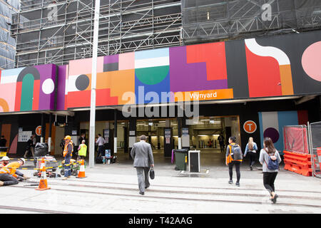 Entrance to Wynyard railway station in George street Sydney with construction hoarding above,Sydney,Australia - Stock Image
