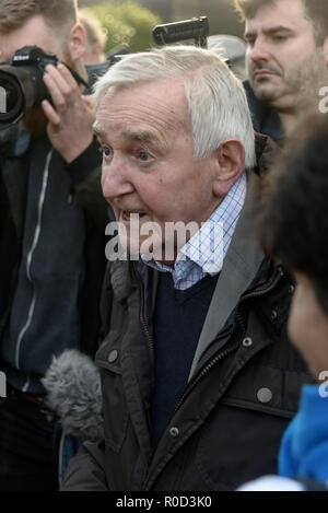 London, UK. 3rd November 2018. Ted Knight comes to confront Class War supporters who came to the 'No Demolitions Without Permission' housing protest at City Hall with banners declaring that Labour Councils were the biggest social cleansers in London and 'Labour, Labour Home Snatchers! Even Worse Than Maggie Thatcher', pointing out that it was largely Labour councils who were demolishing council estates so that developers could replace council houses with large numbers of properties sold at high market prices and a miserably small number of homes at social rent, promoting schemes which cut by t - Stock Image