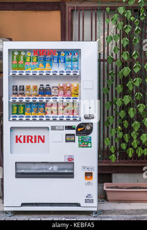 Kirin vending machine full of drinks bottles in a Japan outside a building in an urban environment - Stock Image