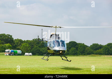 Bell 206L-4 Longranger IV taking off with passengers. A popular light seven seat helicopter - Stock Image