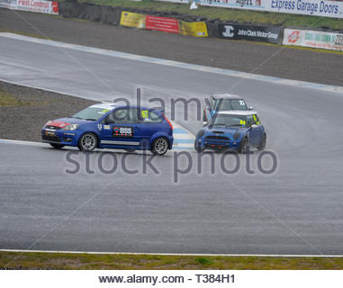 Dunfermline, Scotland, UK. 7th April, 2019.   At the Hairpin during a Scottish Fiesta/Mini Cooper S Cup  race at Knockhill Circuit. During a wet and misty opening round of the Scottish Championship Car Racing season organised by the SMRC (Scottish Motor Racing Club) at Knockhill. Credit: Roger Gaisford/Alamy Live News - Stock Image