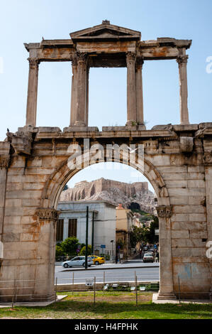 Athens, Greece. The Arch of Hadrian with Acropolis in the background. - Stock Image