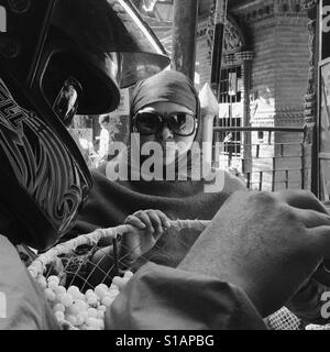 Woman in sunglasses buying grapes, Kathmandu 2017 - Stock Image