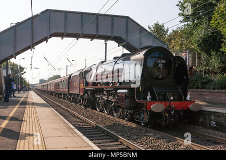 Ex LMS Steam locomotive Duchess of Sutherland No. 6233 passes Chester le Street station on the east coast main line, north east England, UK - Stock Image