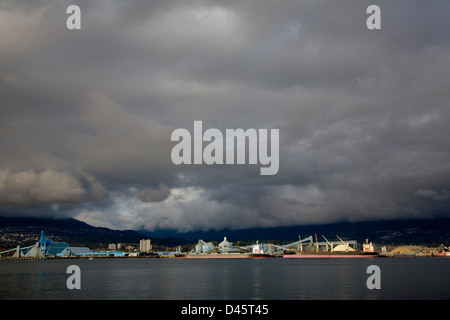 Bulk carrier vessels at Vancouver Wharves terminal, Port of Vancouver, North Vancouver, British Columbia, Canada - Stock Image