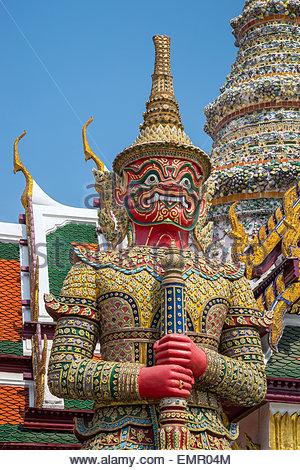Giant demon guard (yaksha) in the Temple of the Emerald Buddha - Wat Phra Kaew - in Bangkok (Thailand) - Stock Image