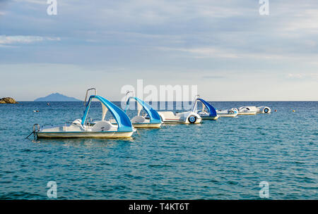Pedal boats or paddle boats with water slides at sea - Stock Image