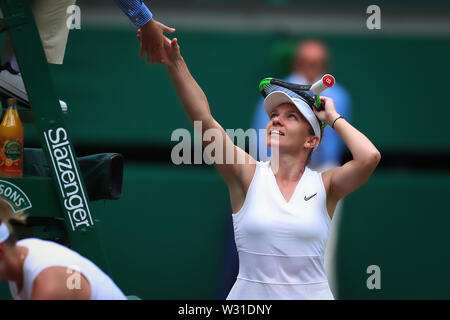 Wimbledon, UK. 11th July 2019, The All England Lawn Tennis and Croquet Club, Wimbledon, England, Wimbledon Tennis Tournament, Day 10; Simona Halep (ROM) shakes hands with the umpire as she wins her match 2-0 Credit: Action Plus Sports Images/Alamy Live News - Stock Image