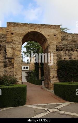 Spain. Seville. Alcazar. Patio de la Monteria (The Hunting Courtyard). Old walls. - Stock Image