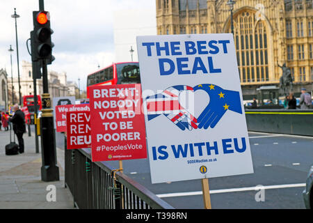 Brexit posters supporters to leave the EU and remainers outside the Houses of Parliament in Westminster, London England UK  4 April 2019  KATHY DEWITT - Stock Image