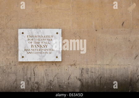 Plaque on blank wall, opposite Banksy graffiti in Park Street, bemoaning that Banksy has not painted this wall. - Stock Image