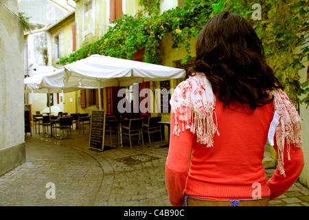 Arles; Bouches du Rhone, France; A girl standing in one of the typical streets in town. MR. - Stock Image