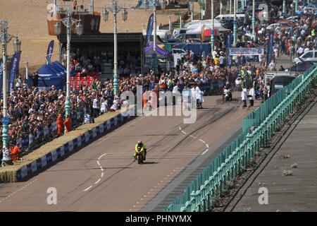Brighton, UK - September 1 2018: A motocycle particiapnt a the National Speed Trials sppeds through Maderia Drive in Brighton​ on 1​ September 2018.   The Pier, in the central waterfront section, opened in 1899 houses amusment rides as well as food kiosks .Credit: David Mbiyu Credit: david mbiyu/Alamy Live News - Stock Image