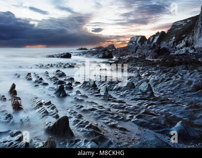 Rocky seashore at Ayrmer Cove in the South Hams District of Devon - Stock Image