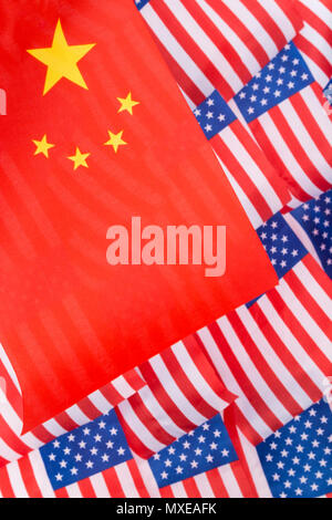 Chinese flag and Stars and Stripes flags - metaphor for Trump trade tariffs on Chinese imports to USA, China US trade war, American trade barriers. - Stock Image