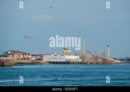 General view on a warm summers evening with a blue sky across Portsmouth Harbour to Clarence Pier seen here with - Stock Image