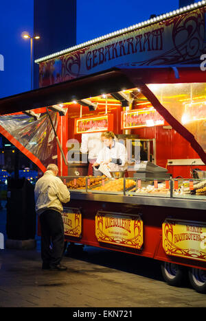 Snack stall at Amsterdam's Schiphol Airport, Holland, selling traditional Dutch food including waffles and pastries, - Stock Image