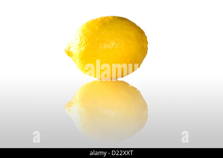 An isolated lemon, with a reflex. - Stock Image
