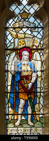 Stained glass window of Saint Michael at Waldringfield church, Suffolk, England, UK c 1917 by Powell - Stock Image